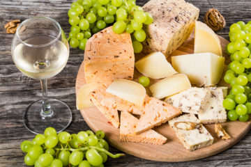 Cheese plate: goat cheese with walnuts, spices and grapes