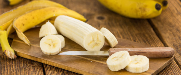 Wooden table with Sliced Bananas, selective focus
